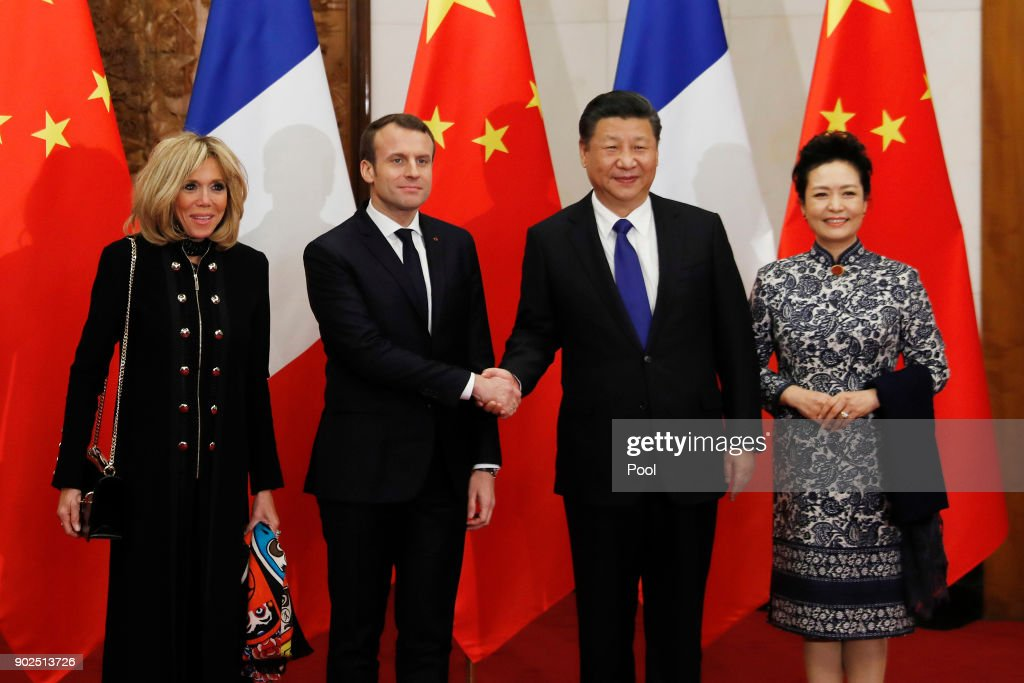 French President Emmanuel Macron, second from left, and wife Brigitte Macron, left, meet with Chinese President Xi Jinping, second from right, and wife Peng Liyuan, right, before a meeting at the Diaoyutai State Guesthouse, during their three day state visit on January 8, 2018 in Beijing, China.