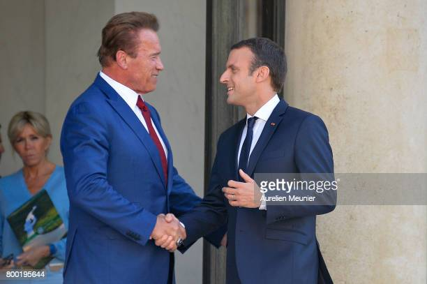 French President Emmanuel Macron shakes hand with Arnold Schwarzenegger after a meeting at the Elysee Palace on June 23 2017 in Paris France On their...