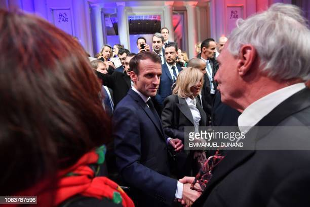 French President Emmanuel Macron shakes hands after delivering a speech during a Frenchspeaking community reception at the BOZAR Centre for Fine Arts...
