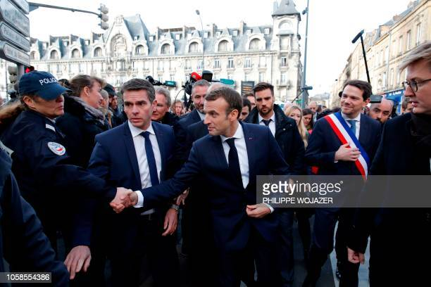 French President Emmanuel Macron shakes hands as he arrives with mayor Boris Ravignon to attend the weekly cabinet meeting at the Ardennes Prefecture...