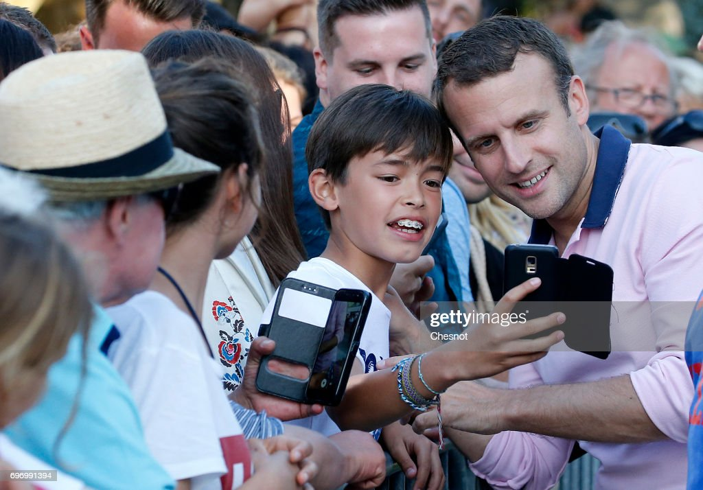 French President Emmanuel Macron, shakes hands as he leaves his home the eve of the second round of the French parliamentary elections on June 17, 2017 in Le Touquet-Paris-Plage, France. The second round of the French legislative elections will take place on June 18, 2017.