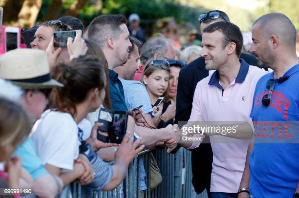 French President Emmanuel Macron shakes hands as he leaves his home the eve of the second round of the French parliamentary elections on June 17 2017...