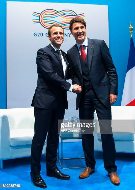 French President Emmanuel Macron shakes hands with Canadian Prime Minister Justin Trudeau during a bilateral meeting on the opening day of the G20...