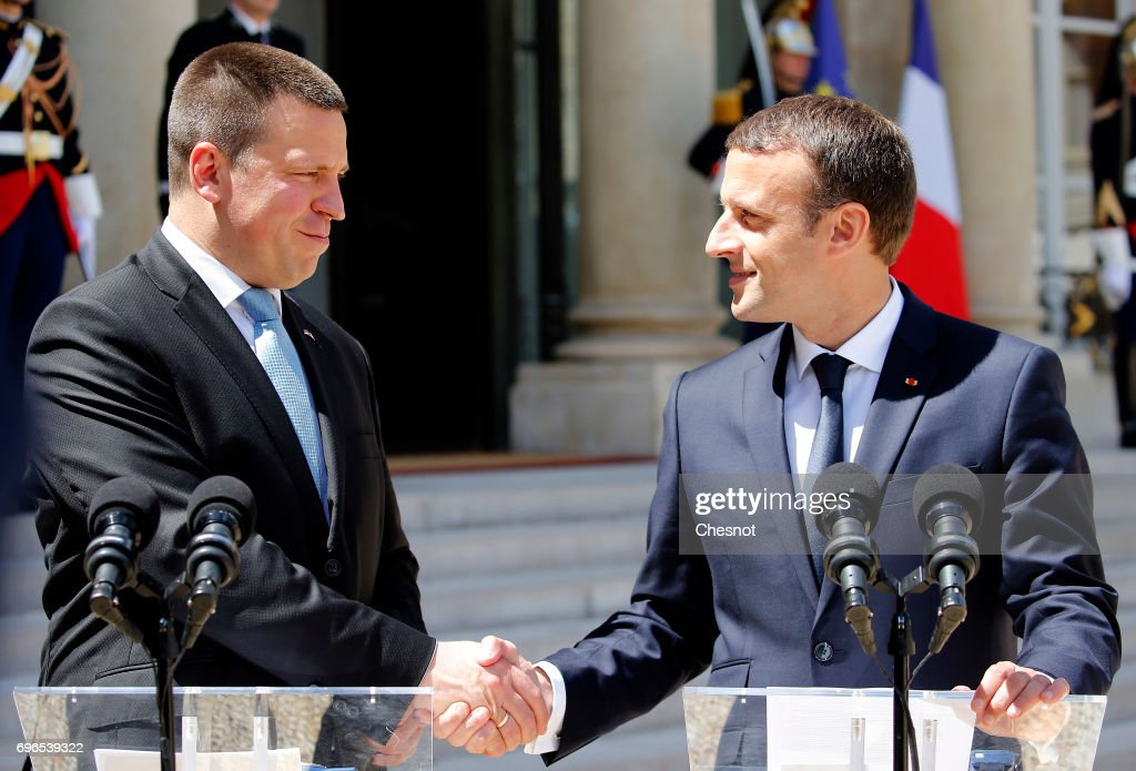 French President Emmanuel Macron shakes hands with Estonian President, Juri Ratas after their meeting at the Elysee on June 16, 2017, in Paris France. Ratas is on an official visit to Paris.