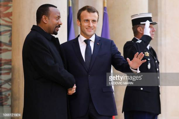 French president Emmanuel Macron shakes hands with Ethiopian Prime Minister Abiy Ahmed as he welcomes him upon his arrival at the Elysee Palace,...