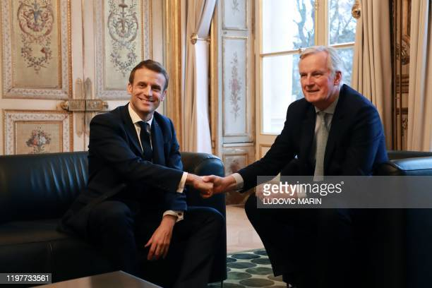 French president Emmanuel Macron shakes hands with European Commission Chief Negociator Michel Barnier prior to their meeting at the Elysee palace in...