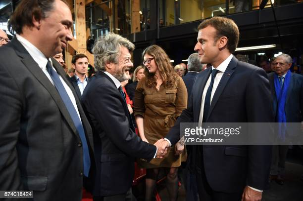 French President Emmanuel Macron shakes hands with former French minister and President of the Fondation Energies pour l'Afrique JeanLouis Borloo as...