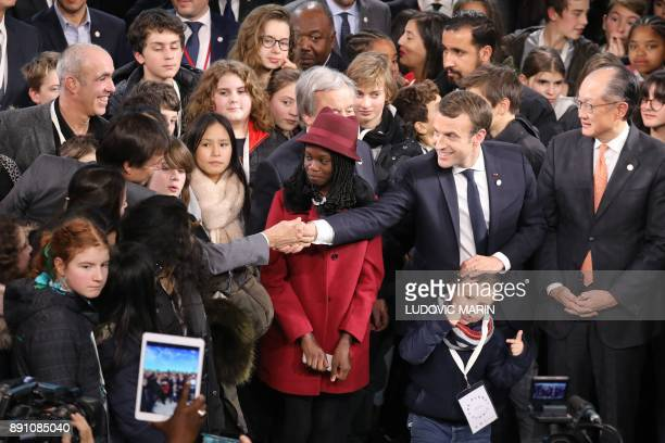 French President Emmanuel Macron shakes hands with French Minister for the Ecological and Inclusive Transition Nicolas Hulot at the end of the One...
