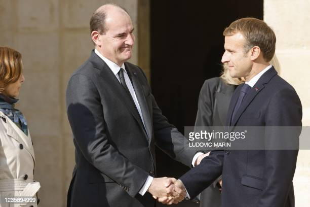 French President Emmanuel Macron shakes hands with French Prime Minister Jean Castex at the end of a national memorial service for Hubert Germain -...