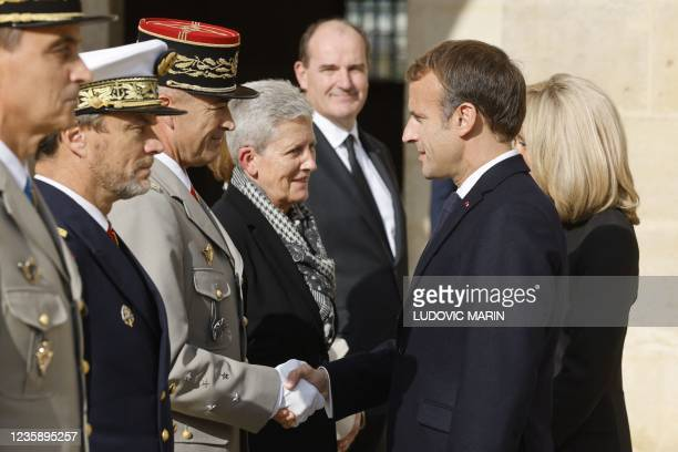 French President Emmanuel Macron shakes hands with General Thierry Burkhard, chief of Defence staff at the end of a national memorial service for...