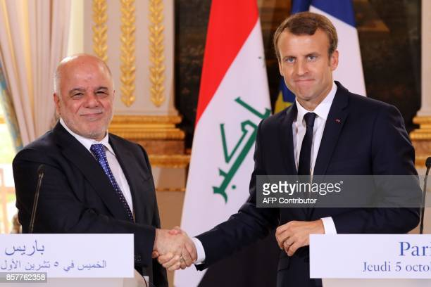 French president Emmanuel Macron shakes hands with Iraqi Prime minister Haider alAbadi at the end of a press conference at the Elysee palace in Paris...
