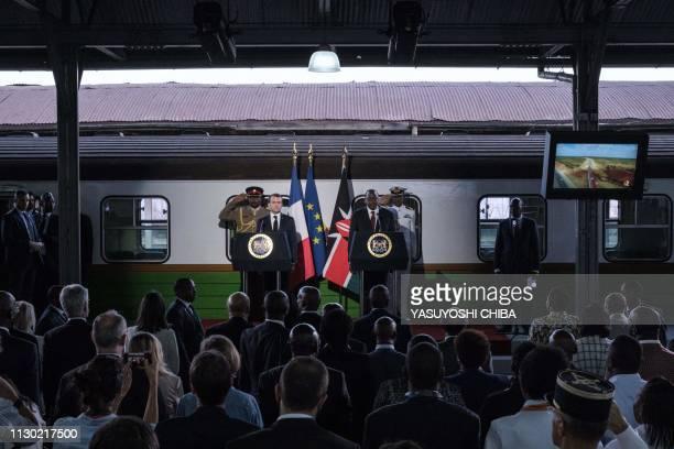 French President Emmanuel Macron shakes hands with Kenyan President Uhuru Kenyatta listen national anthems during an event at Nairobi Central Railway...