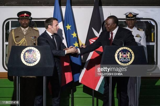 French President Emmanuel Macron shakes hands with Kenyan President Uhuru Kenyatta during an event at Nairobi Central Railway Station in Nairobi on...