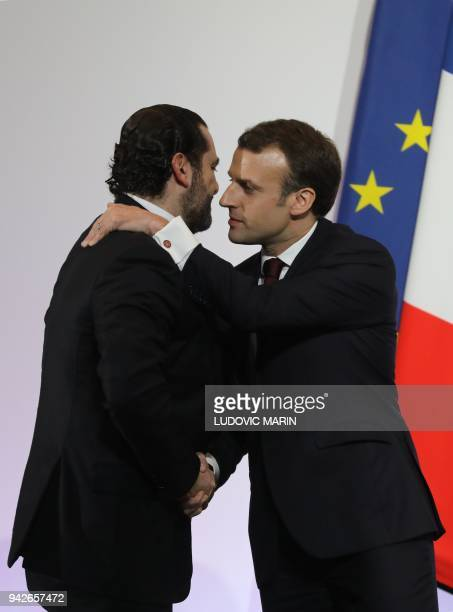 French President Emmanuel Macron shakes hands with Lebanese Prime Minister Saad Hariri during the International CEDRE Conference on April 6 2018 in...