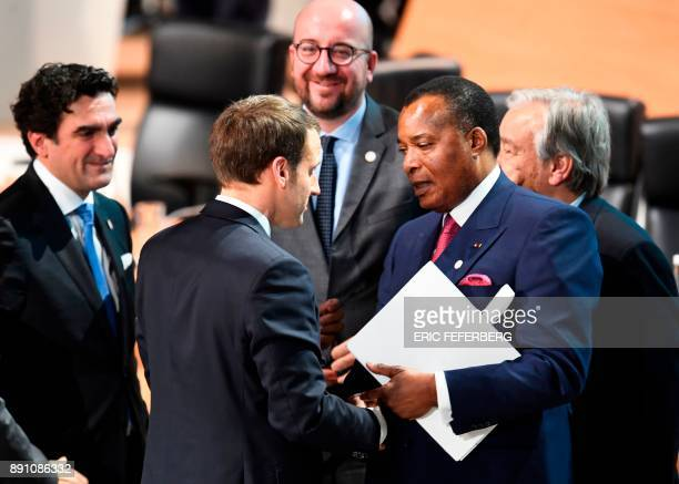 French president Emmanuel Macron shakes hands with President of the Republic of Congo Denis SassouNguesso at the close of the One Planet Summit on...