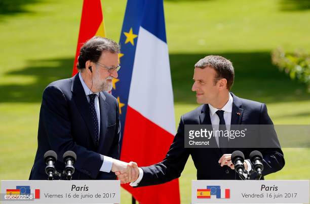 French President Emmanuel Macron shakes hands with Prime Minister Mariano Rajoy at the end of a press conference at the Elysee Presidential Palace on...