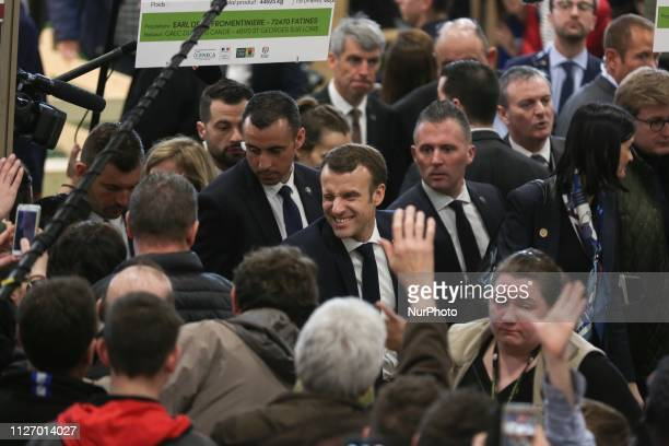 French President Emmanuel Macron shakes hands with visitors has he visits the 56th International Agriculture Fair at the Porte de Versailles...