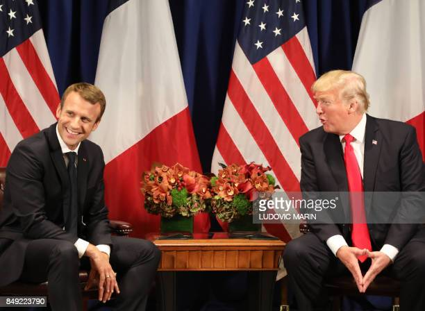 French President Emmanuel Macron shares a light moment with US President Donald Trump speaks during their meeting in New York on the sidelines of the...