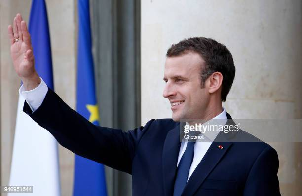 French president Emmanuel Macron smiles as Canadian Prime Minister Justin Trudeau leaves the Elysee Palace after their meeting on April 16 2018 in...