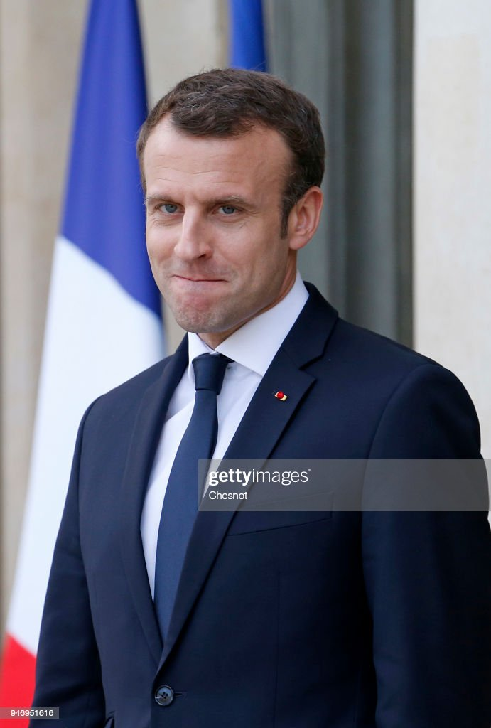 French president Emmanuel Macron smiles as Canadian Prime Minister Justin Trudeau leaves the Elysee Palace after their meeting on April 16, 2018 in Paris, France. Trudeau is in Paris for a two-day visit.