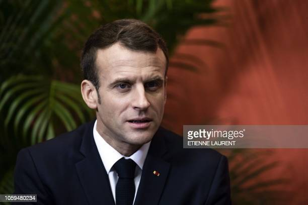 French President Emmanuel Macron smiles during a meeting with associations and the people they help in Lens on November 9 2018 as part of his tour to...