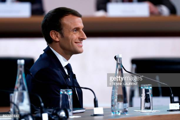French President Emmanuel Macron smiles during the Plenary Session of the One Planet Summit at the Seine Musicale event site on the Ile Seguin near...