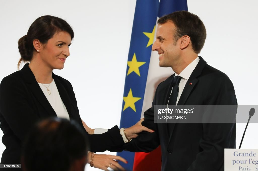 French President Emmanuel Macron (R) smiles to French Junior Minister for Gender Equality Marlene Schiappa after he delivered a speech during the International Day for the Elimination of Violence Against Women, on November 25, 2017 at the Elysee Palace in Paris. /