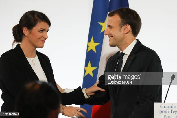 French President Emmanuel Macron smiles to French Junior Minister for Gender Equality Marlene Schiappa after he delivered a speech during the...