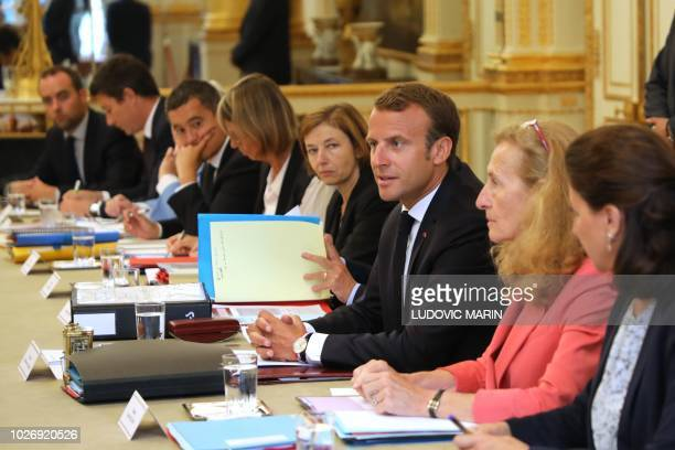 French President Emmanuel Macron speaks among his ministers during the weekly cabinet meeting at the Elysee Palace on September 5 in Paris following...