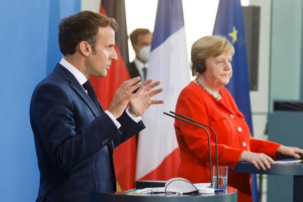 DEU: German Chancellor Angela Merkel And French President Emmanuel Macron Give A News Statement In Berlin