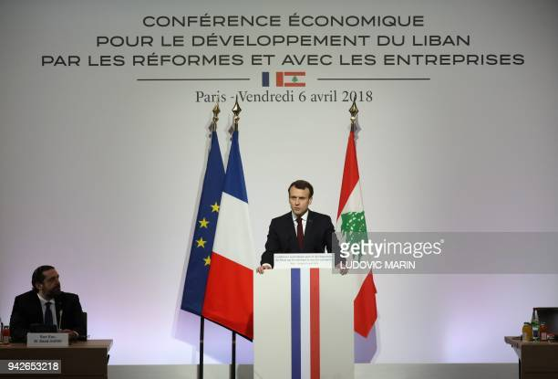 French President Emmanuel Macron speaks as Lebanese Prime Minister Saad Hariri looks on during the International CEDRE Conference on April 6 2018 in...