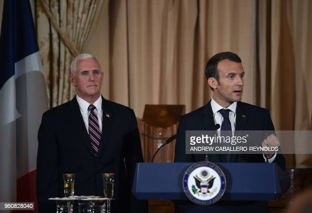 French President Emmanuel Macron speaks as US Vice President Mike Pence looks on during a luncheon at the US State Department in Washington DC on...