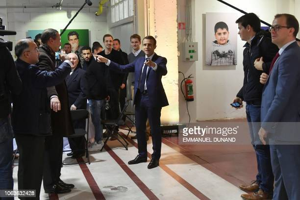 French President Emmanuel Macron speaks at the cultural center LaVallee a 6000 squaremetre coworking space at the heart of Molenbeek on November 20...