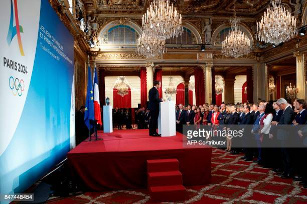 French President Emmanuel Macron speaks during a ceremony at the Elysee Palace in Paris on September 15 2017 to celebrate Paris' coronation as host...