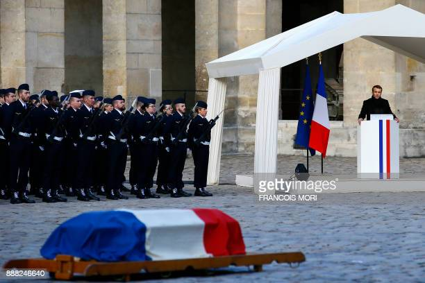 French president Emmanuel Macron speaks during a National Tribute ceremony for late member of the Academie Francaise Jean d'Ormesson at the Invalides...