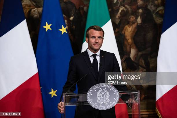 French President Emmanuel Macron speaks during a press conference at Palazzo Chigi in Rome