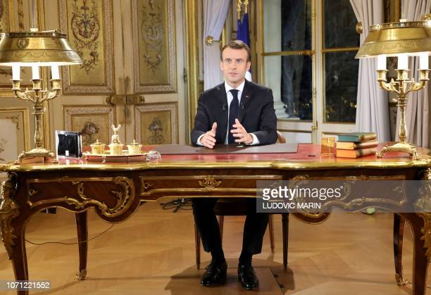 French President Emmanuel Macron speaks during a special address to the nation, his first public comments after four weeks of nationwide 'yellow...