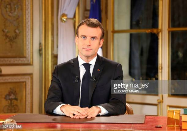 TOPSHOT French President Emmanuel Macron speaks during a special address to the nation his first public comments after four weeks of nationwide...