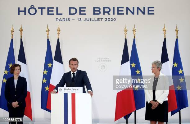 French President Emmanuel Macron speaks flanked by French Defence Minister Florence Parly and French Junior Minister of Remembrance and Veterans...