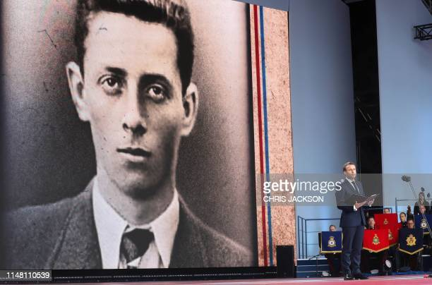 French President Emmanuel Macron speaks in front of an image of 16 yearold French resistance fighter Henri Fertet during an event to commemorate the...
