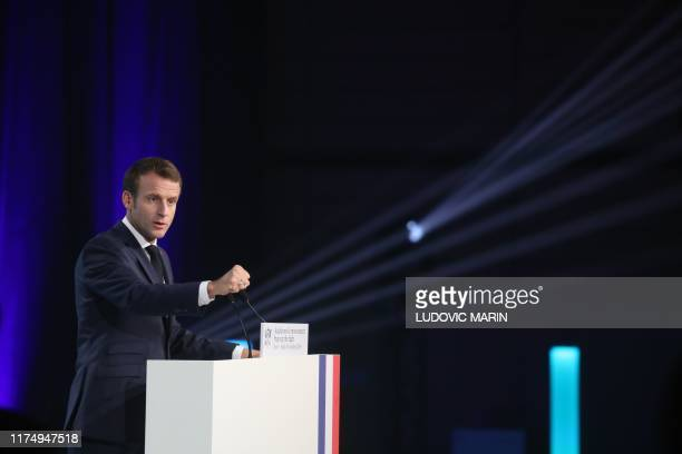 French President Emmanuel Macron speaks in Lyon, central eastern France, on October 10 on the second day of the conference of Global Fund to Fight...