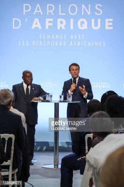 French President Emmanuel Macron speaks next to Ghanaian President Nana AkufoAddo during a debate entitled in French Parlons d'Afrique gathering...