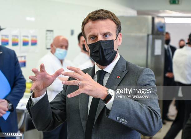 French President Emmanuel Macron speaks to journalists at the Hospitality school in Tain l'Hermitage on June 8 during a visit in the French...