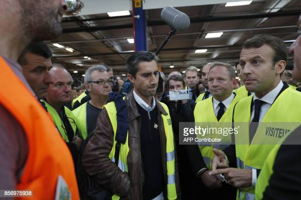 French President Emmanuel Macron speaks to La France Insoumise leftist party's MP Francois Ruffin during a visit to the Whirlpool factory in Amiens...