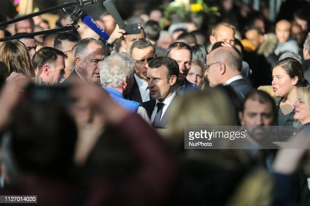 French President Emmanuel Macron speaks with breeders as he visits the 56th International Agriculture Fair at the Porte de Versailles exhibition...