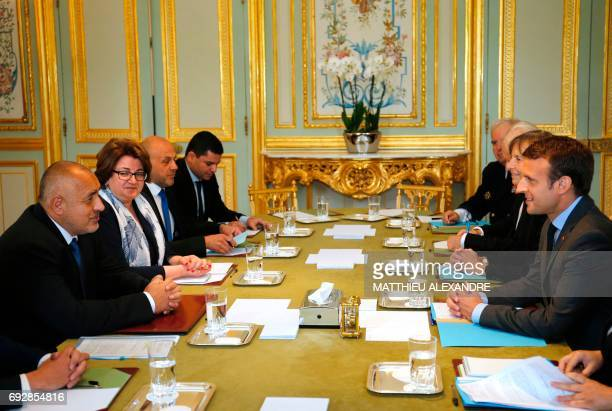 French President Emmanuel Macron speaks with Bulgarian new Prime Minister Boiko Borissov during a meeting at the Elysee Palace in Paris on June 6...