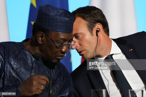 French President Emmanuel Macron speaks with Chadian President Idriss Deby during a meeting with EU and African leaders to discuss how to ease the...