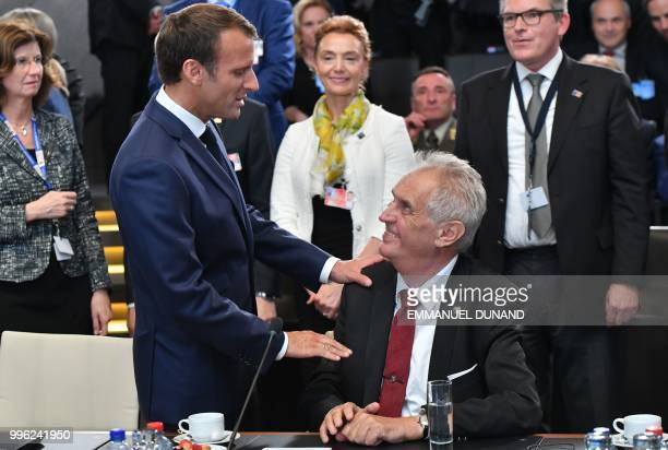 French President Emmanuel Macron speaks with Czech Republic President Milos Zeman after arriving to attend the North Atlantic Council meeting during...