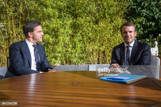 French president Emmanuel Macron speaks with Dutch Prime Minister Mark Rutte at the Elysee presidential palace on August 31 in Paris / AFP PHOTO /...