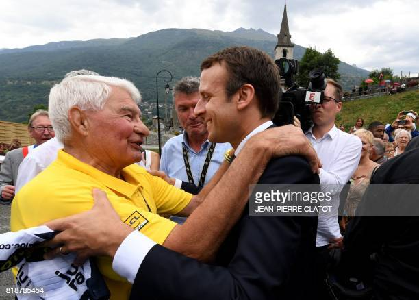 French President Emmanuel Macron speaks with former French cyclist Raymond Poulidor on July 19 in SaintMartind'Arc as he arrives to meet former...
